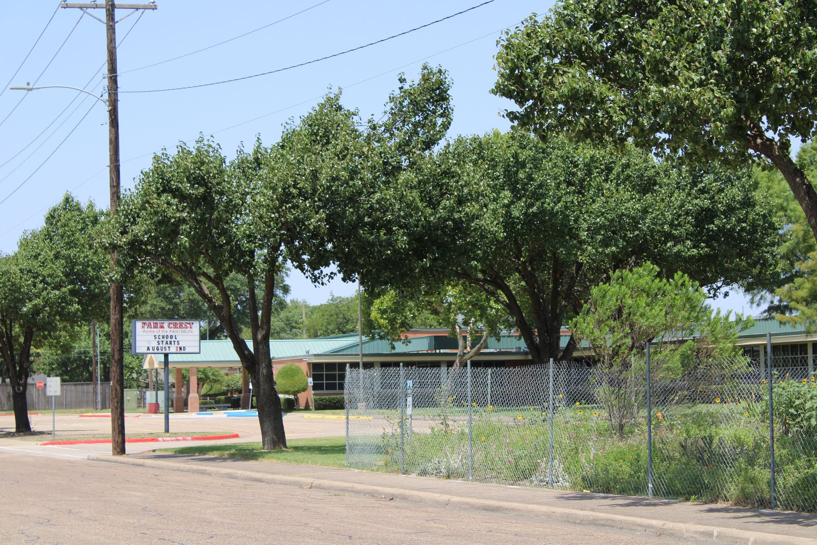 A company placed fencing around a garden at Park Crest Elementary School on July 23.