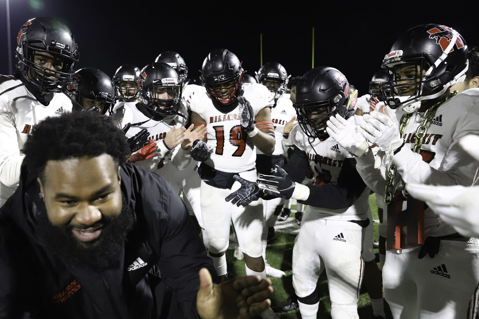 Hillcrest outside linebackers coach Antonio Dudley leads the team in a chant after a win against Spruce at James Ray Henry Stadium in Seagoville, Texas, Friday, December 4, 2020. (Elias Valverde II / Special Contributor)