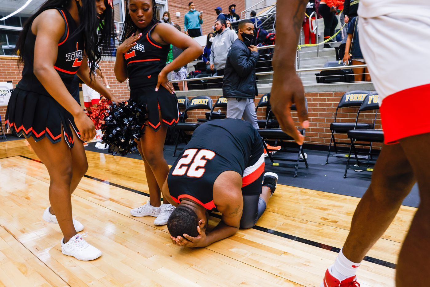 Lancaster's Damon Walker (32) falls to his knees after his team's loss to Kimball following overtime of a boys basketball UIL Class 5A Region II playoff game in Forney on Friday, March 5, 2021. (Juan Figueroa/ The Dallas Morning News)
