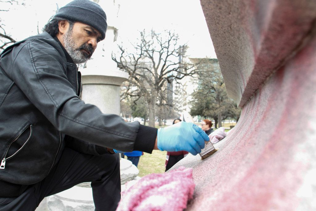 Humberto DeGarrio from Bronze Conservation spent Monday morning removing graffiti from the Confederate War Memorial Monday.