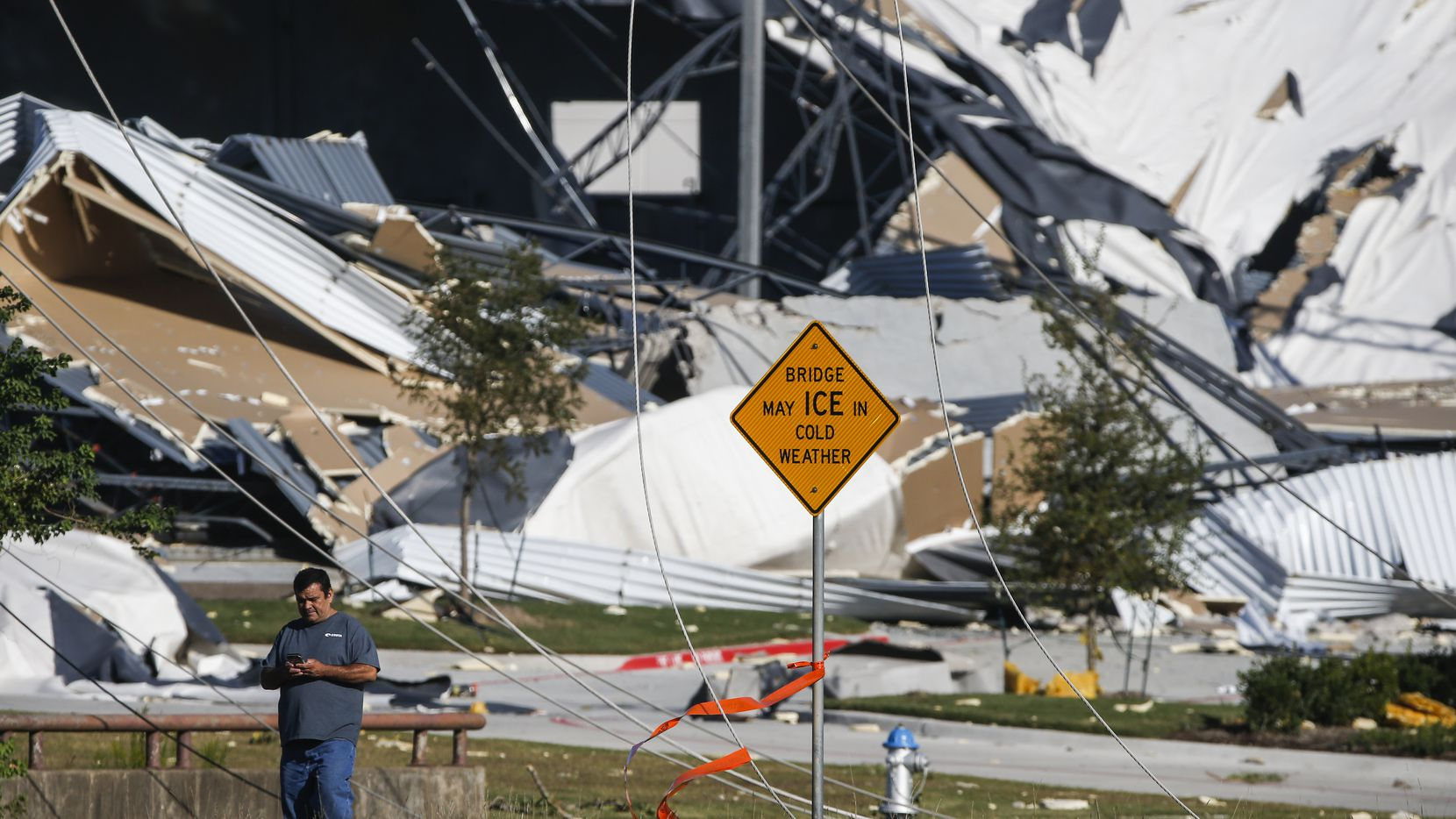 A collapsed building, damaged from a tornado the night before is seen near West Miller Road and South Shiloh Road in Garland, Texas, on Sunday, Oct. 21, 2019.