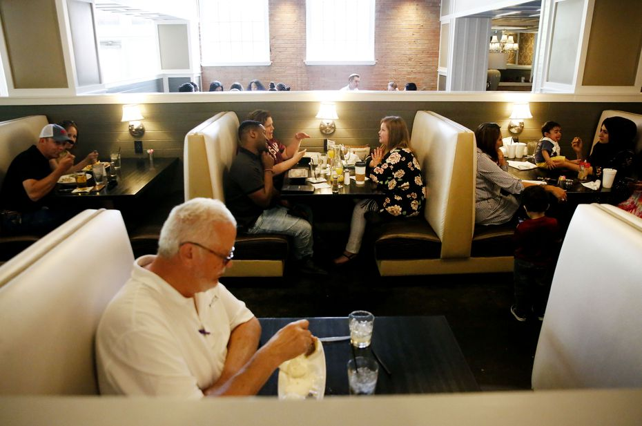 """Ellen's Restaurant in the West End now has a new """"waiting room"""" just outside its doors, says partner Joe Groves: A new park serves as a lovely spot for customers to wait in pleasant weather."""