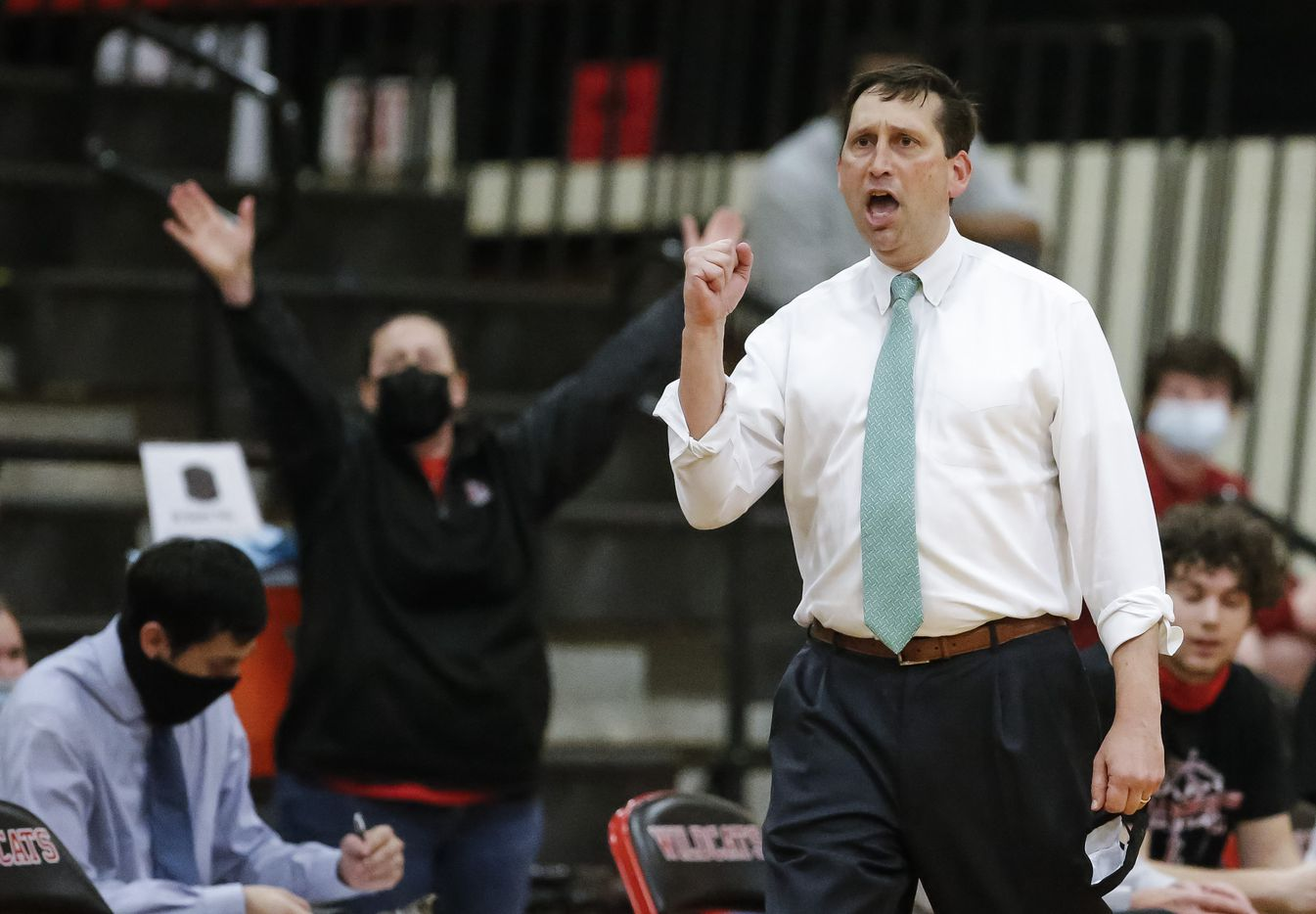 Lovejoy head coach Kyle Herrema celebrates his team scoring during the first half of a Class 5A area-round playoff basketball game against South Oak Cliff at Lake Highlands High School in Dallas, Wednesday, February 24, 2021. (Brandon Wade/Special Contributor)