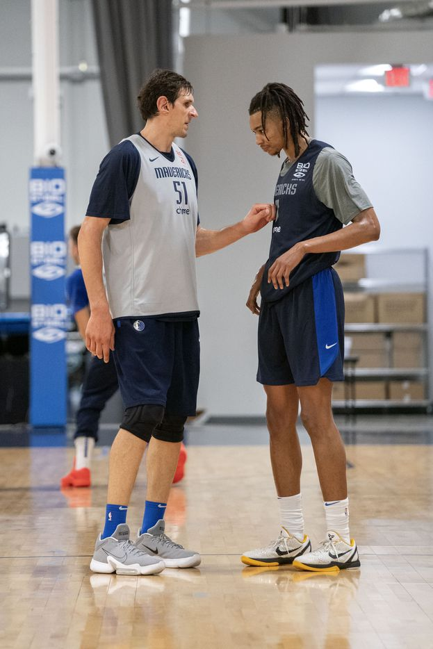 Dallas Mavericks centers Boban Marjanović (51) and Moses Brown (9) pause to talk during a one-on-one drill in a training camp practice Wednesday, September 29, 2021 at the Dallas Mavericks Training Center in Dallas. (Jeffrey McWhorter/Special Contributor)