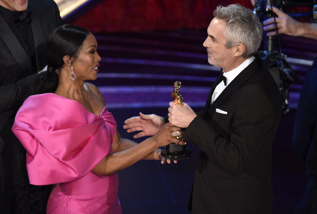 Alfonso Cuarón ganó por mejor cinematografía y mejor dirección por Roma.(Chris Pizzello/Invision/AP)