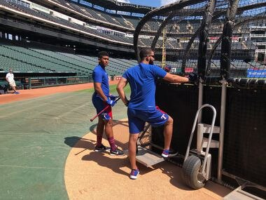 New Rangers prospect Bayron Lora, left, took batting practice with the Rangers on Wednesday. He's pictured here with Nomar Mazara