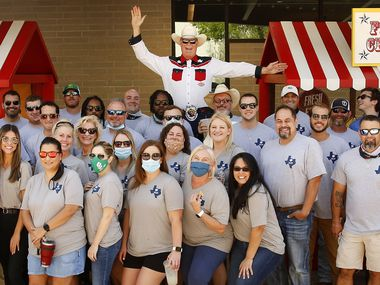 Dressed and posing as Big Tex, Scott + Reid General Contractors founder and president Brad Reid joined his employees for a photo during the company's (Un)Fair Day in Addison on Sept. 25. Usually on opening day of the State Fair of Texas, the employees get the day off to spend at the fair. Instead, they brought their own midway to the company's parking lot.