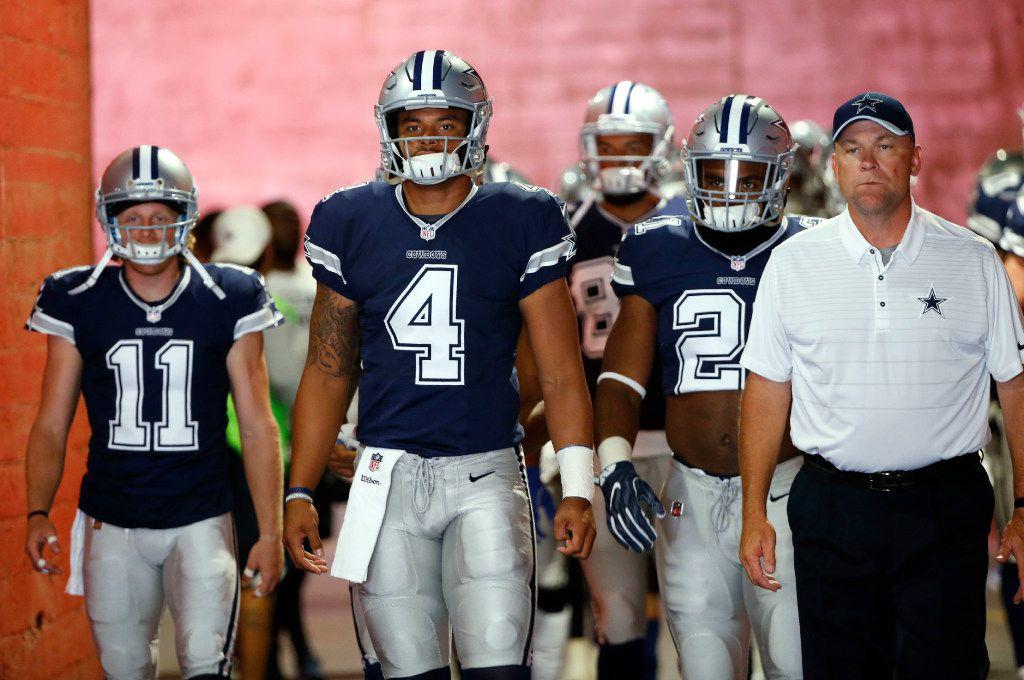 Dallas Cowboys wide receiver Cole Beasley (11), Dallas Cowboys quarterback Dak Prescott (4), Dallas Cowboys running back Ezekiel Elliott (21) and Dallas Cowboys offensive coordinator Scott Linehan and team make their way to the field before a game against the Los Angeles Rams at Los Angeles Memorial Coliseum in Los Angeles, California on Saturday, August 12, 2017. (Vernon Bryant/The Dallas Morning News)