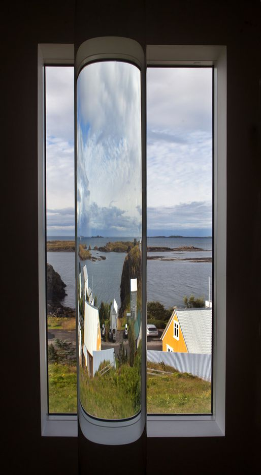 Interior installation detail of one of 24 glass cylinders holding water from ice of Iceland's major glaciers at artist Roni Horn's  Library of Water in Stykkishólmur, Iceland