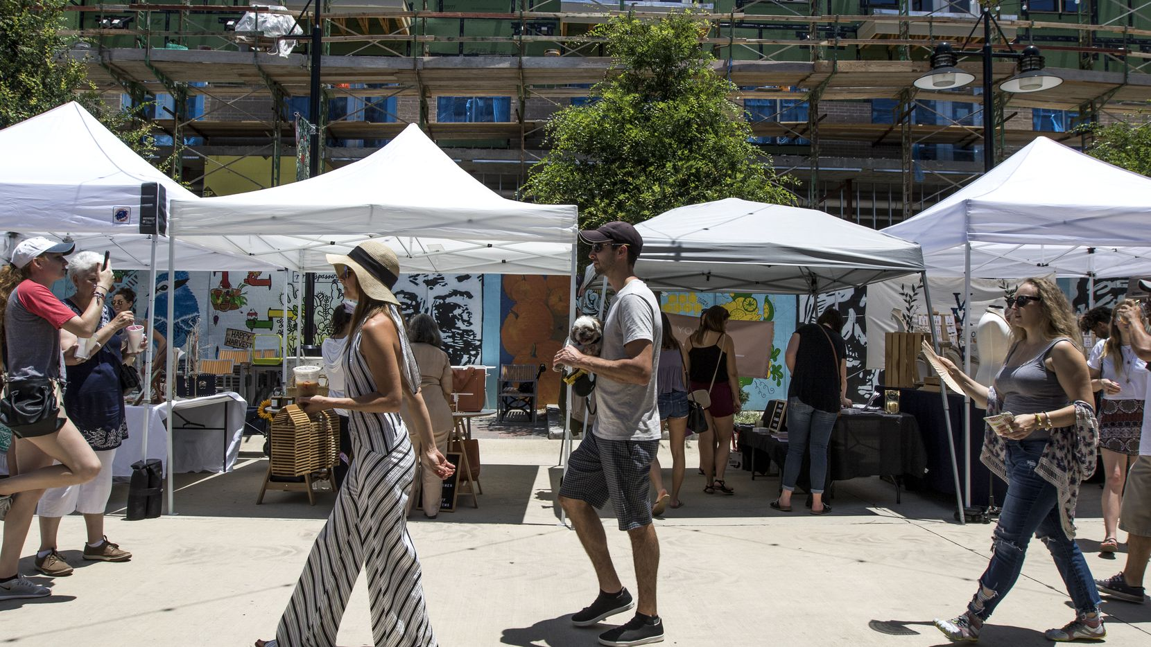 People walk through the pop-up Boho Market at Dallas Farmers Market in Dallas on June 9, 2018. (Carly Geraci/The Dallas Morning News)