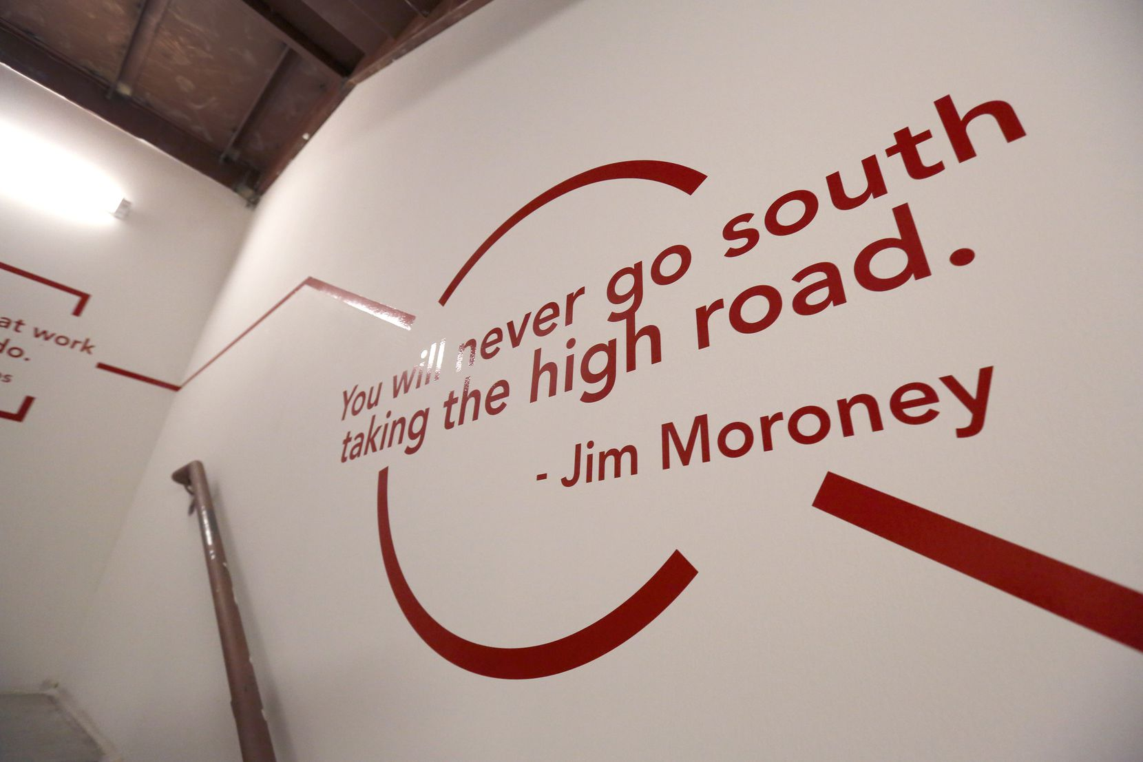 A quote from Jim Moroney can be seen in a stairwell at The Dallas Morning News' building on Commerce Street downtown.