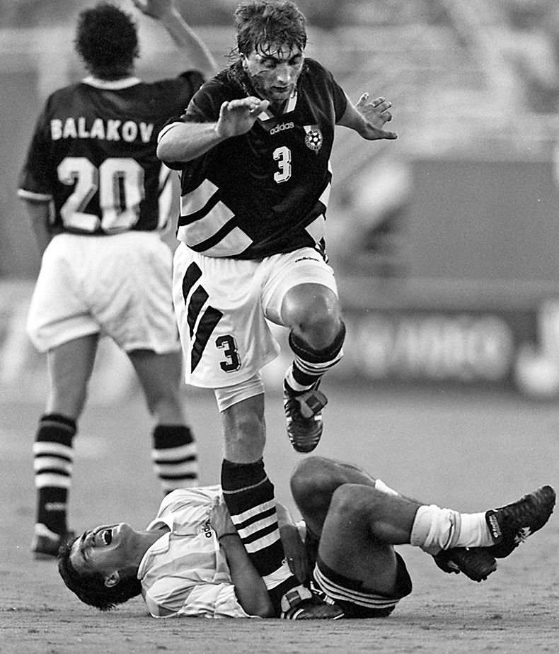 June 30, 1994--Bulgaria's Trifon Ivanov (3) steps on and over an Argentinian player in Bulgaria's 2-0 win during 1994 FIFA World Cup Competition held at the Cotton Bowl in Dallas. (Lois DeLuca/The Dallas Morning News)