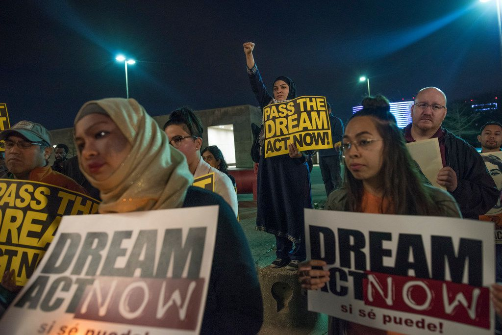 Protesters  gather for a a vigil in support of DACA at Dallas City Hall on Monday, March5, 2018.  Members of the muslim community joined them. (Rex C. Curry/Special Contributor)