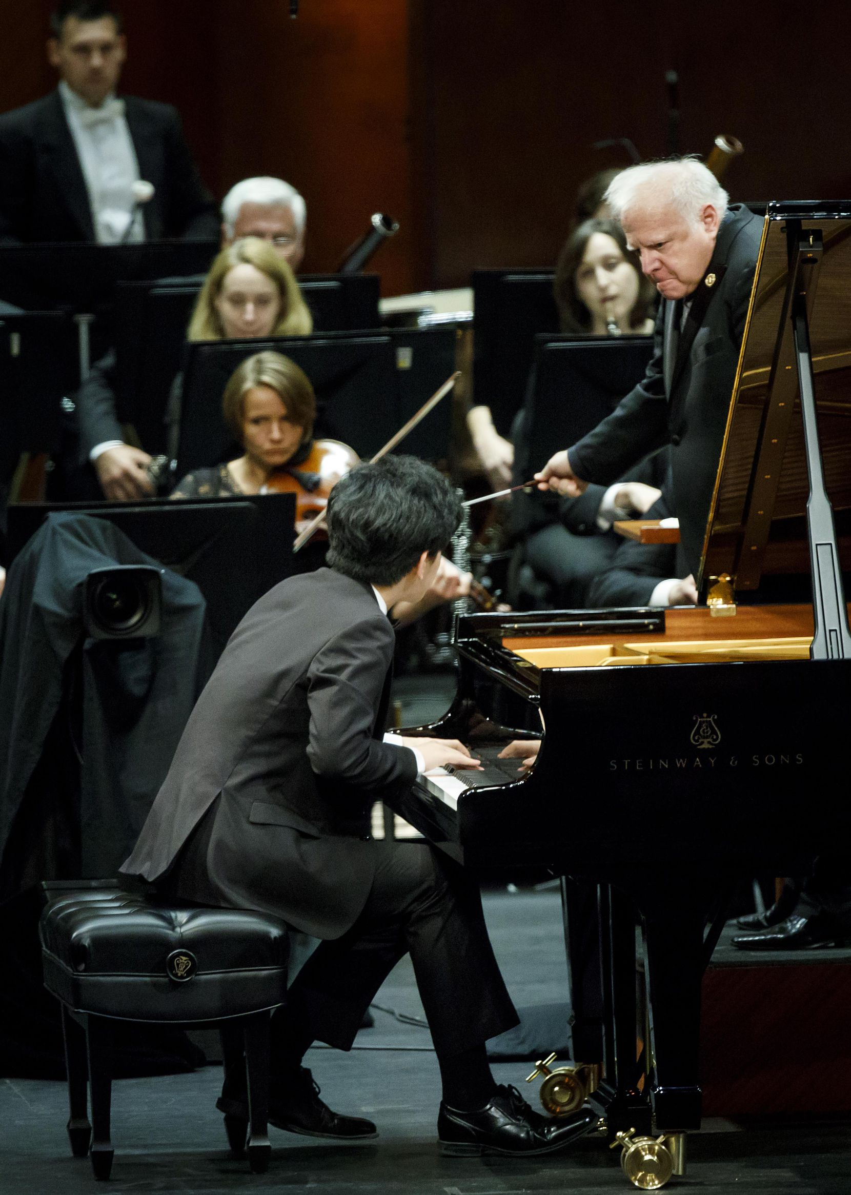 Daniel Hsu performs a piano concerto with the Fort Worth Symphony Orchestra, led by Leonard Slatkin, in the final round of the Van Cliburn International Piano Competition at Bass Performance Hall on June 10, 2017, in Fort Worth.