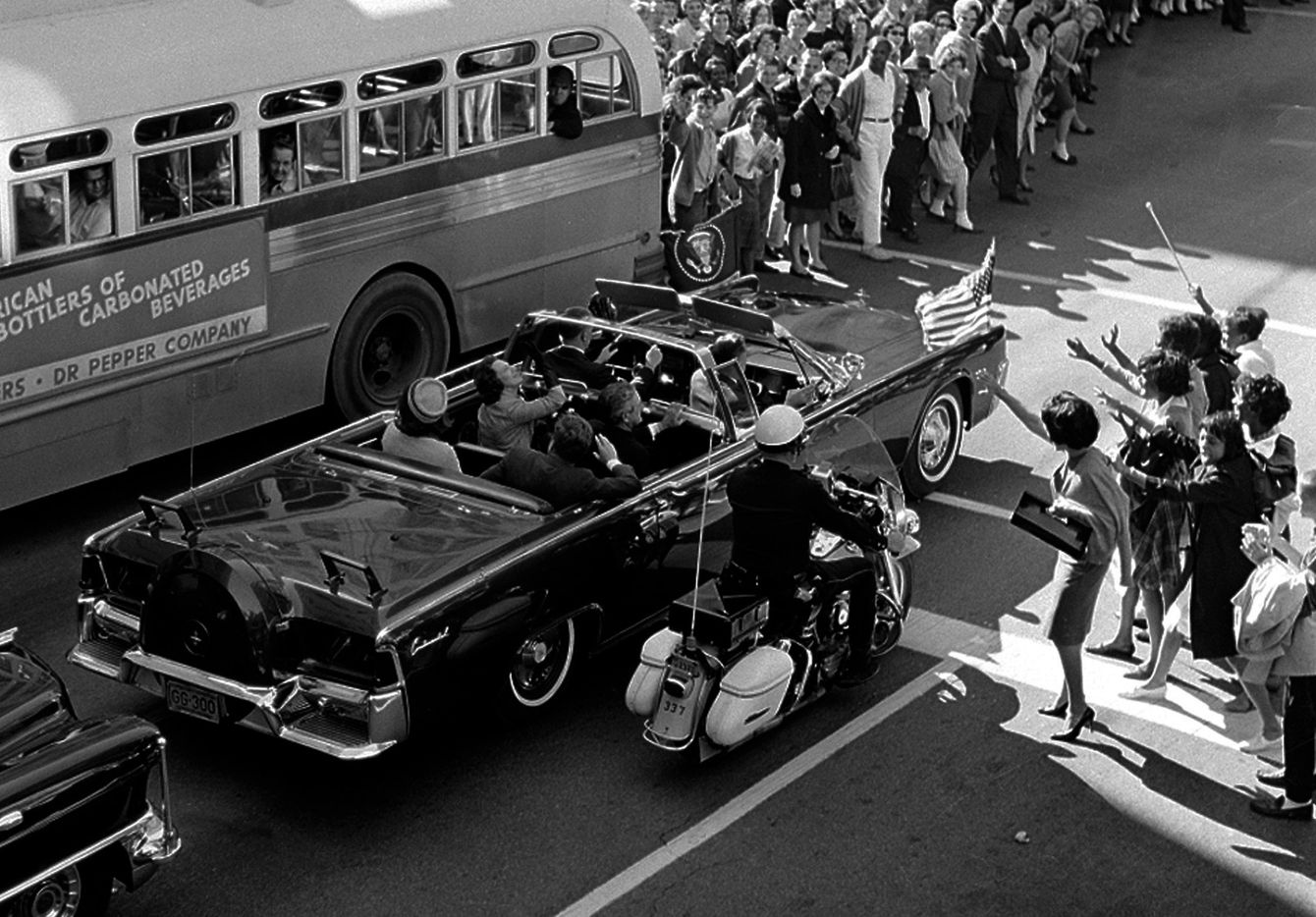 Fans of the president and first lady were able to get within feet of the open limousine on Main Street at Ervay Street in Dallas as the motorcade approached Dealey Plaza on Nov. 22, 1963.