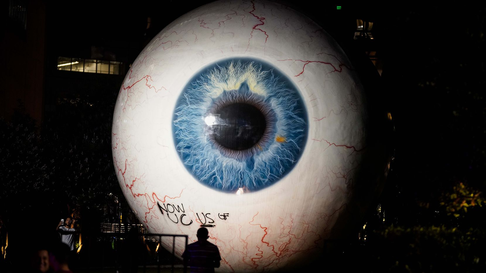 "Graffiti is seen on the giant eyeball sculpture, ""Eye,"" following a protest against police brutality in the early morning hours of Saturday, May 30, 2020, in Dallas. The protest against police brutality was organized by Next Generation Action Network in response to the in-custody death of George Floyd in Minneapolis."