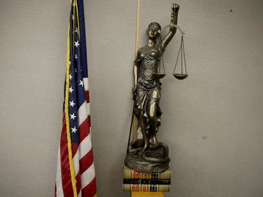 Stock art of a statue of Lady Justice in a courtroom in the Frank Crowley Courts Building in Dallas Thursday December 18, 2018. (Andy Jacobsohn/The Dallas Morning News)