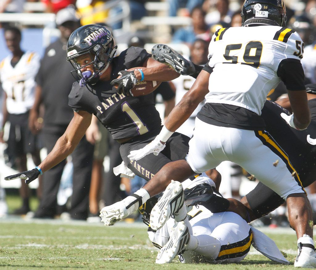 Prairie View running back Dawonya Tucker (1) spins for extra yardage against the Grambling State defense during first half action. The two  teams lined up for their annual college gridiron challenge at the Cotton Bowl on the state fairgrounds in Dallas on September 28, 2019.
