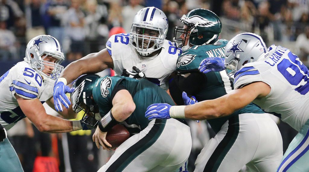Dallas Cowboys defensive tackle Cedric Thornton (92) and defensive end Tyrone Crawford (98) sack Philadelphia Eagles quarterback Carson Wentz (11) in the fourth quarter with outside linebacker Sean Lee (50) nearby during a National Football League game between the Philadelphia Eagles and Dallas Cowboys at AT&T Stadium in Arlington, Texas Sunday October 30, 2016. The Dallas Cowboys beat the Philadelphia Eagles 29-23 in overtime. (Andy Jacobsohn/The Dallas Morning News)