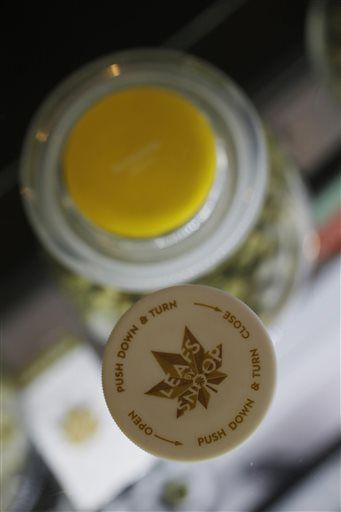This Friday, Dec. 18, 2015, photo, shows the branded top used to cap purchases at the LivWell store in the marijuana line marketed by rapper Snoop Dogg, south of downtown Denver. The rapper is not the only celebrity with a marijuana line as others, such as Willie Nelson and descendants of Bob Marley, are scrambling to brand and trademark pot products in the industry as it becomes part of the mainstream.