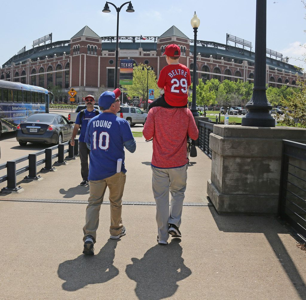 Three generations of baseball fans head to the stadium for mopening day--grandfather Mike Walker, son Kevin Walker and grandson Ryan Walker, all of Rockwall, left to right. Today is the season opener  between the Houston Astros and the Texas Rangers at Globe Life Park in Arlington, photographed on Thursday, March 29, 2018.