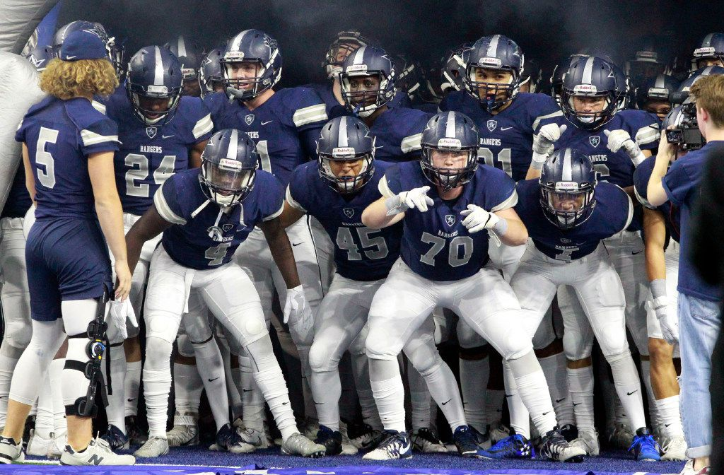 The Frisco Lone Star High team gets worked up before taking the field for the start of a high school football game against Frisco Lakeland High on Friday, October 14, 2016. (John F. Rhodes / Special Contributor)