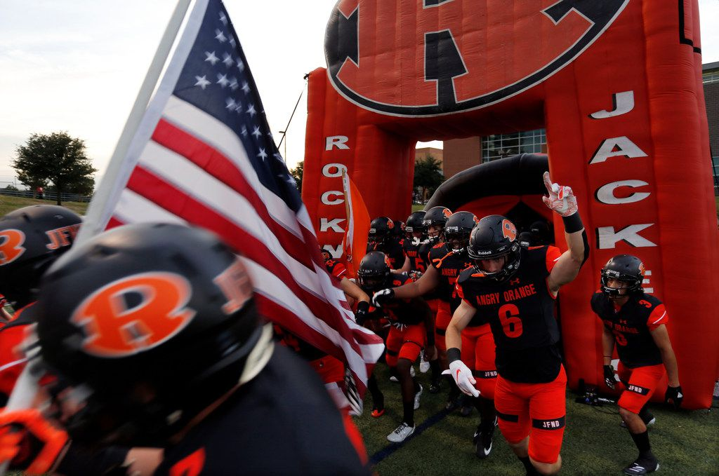 The Rockwall Yellowjackets enter the field before the start of a high school football game against Highland Park at Wilkerson-Sanders Stadium in Rockwall on Friday, August 30, 2019. (John F. Rhodes / Special Contributor)