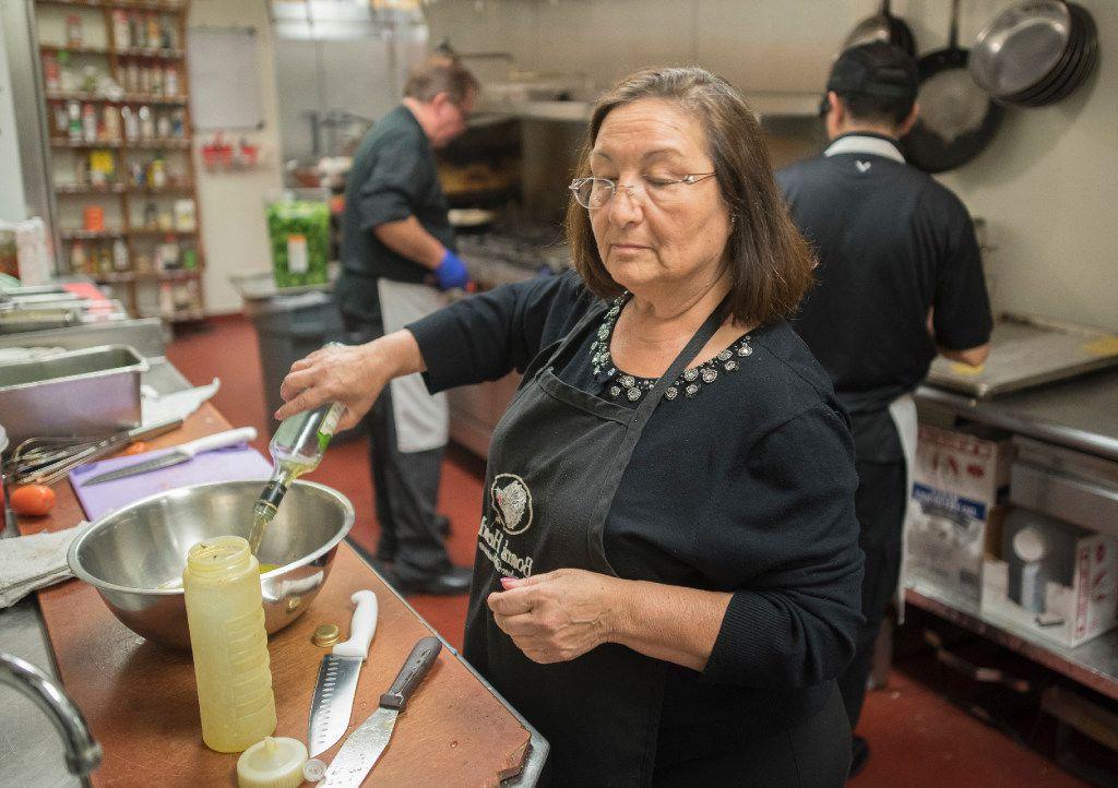 Semira Pacifico prepares a vinaigrette dressing at the Italian Club of Dallas.