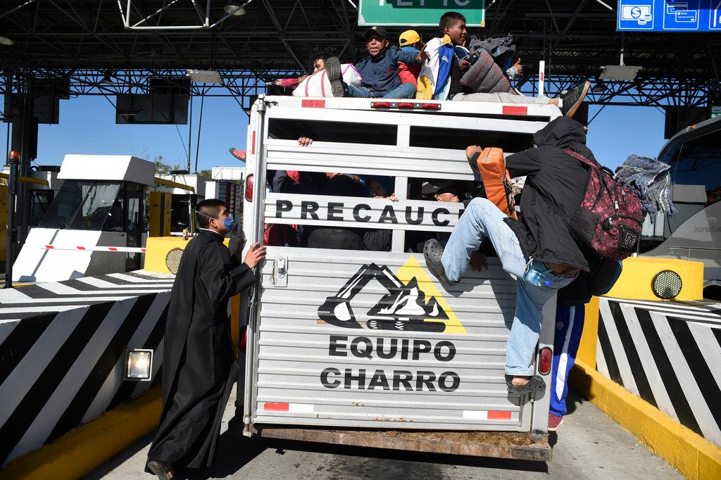 Central American migrants climbed aboard a truck on the road between Zapopan and Tequila, in the Mexican state of Jalisco, on Nov. 13.