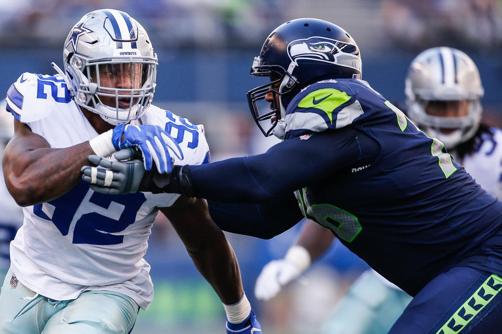 SEATTLE, WA - SEPTEMBER 23:  Defensive End Dorance Armstrong #92 of the Dallas Cowboys tries to get passed Tackle Duane Brown #76 of the Seattle Seahawks during the second half at CenturyLink Field on September 23, 2018 in Seattle, Washington.  (Photo by Otto Greule Jr/Getty Images)