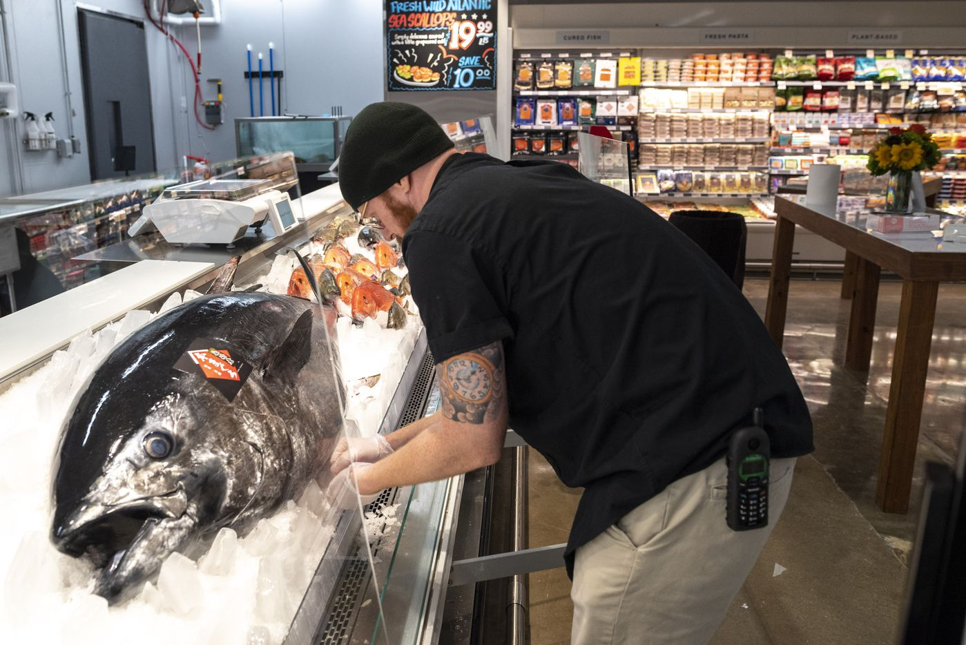 Seafood manager Lee Brady prepares a huge Takashima Bluefin Tuna displayed in the expanded seafood market in the Central Market at Preston and Royal.