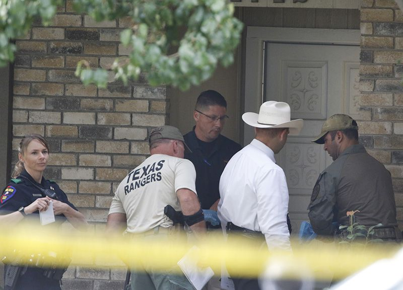 Plano police and Texas Rangers work the scene Monday morning at a house in Plano where seven people were fatally shot Sunday night before the attacker was killed by a police officer. (David Woo/Staff Photographer)
