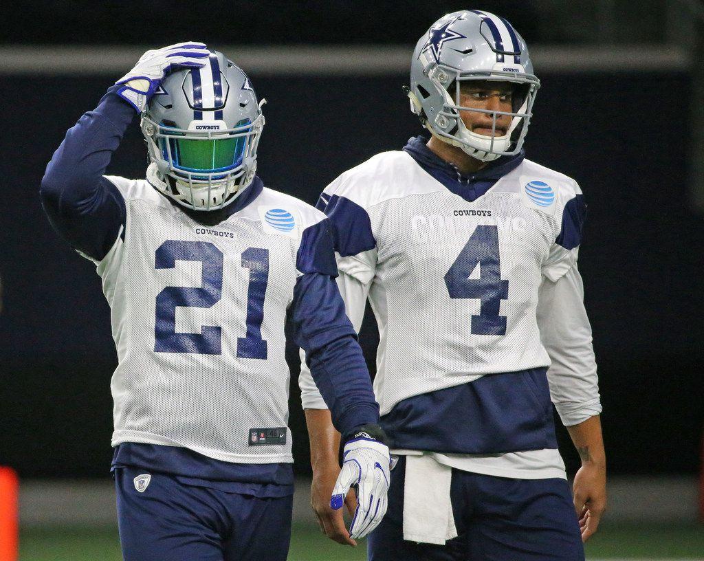 Dallas Cowboys running back Ezekiel Elliott (21) is back at practice with quarterback Dak Prescott (4) at the Star in Frisco, Texas on Friday, November 3, 2017. (Louis DeLuca/The Dallas Morning News)