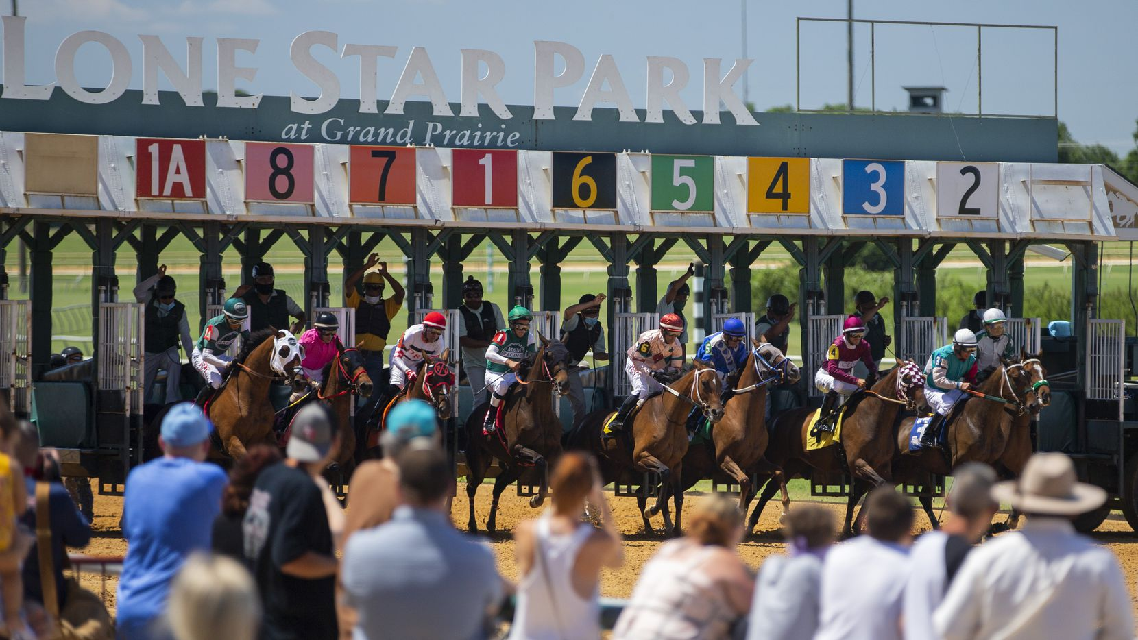 Fans look on during the start of a Claiming race at Lone Star Park in Grand Prairie, Sunday, June 14, 2020.