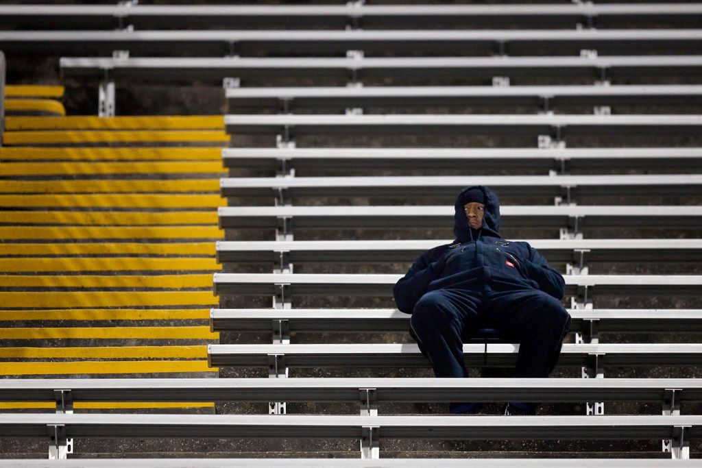 A bundled up Martin Warrior football fan watches the game against Bowie at Maverick Stadium in Arlington, Texas, Thursday, November 7, 2019. Temperatures were in the low 40's with a north wind during the game. (Tom Fox/The Dallas Morning News)