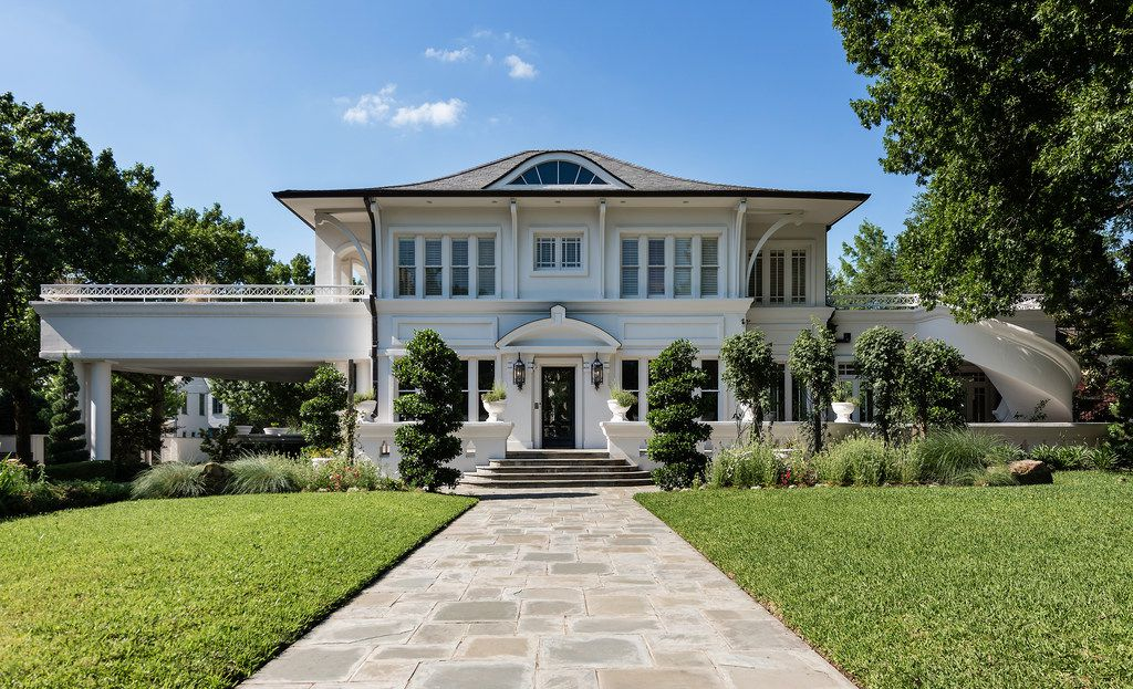 A $12.5 million Highland Park estate owned by a tax attorney recently visted by the feds is up for grabs.