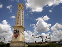 A large obelisk greets people to the city of Desoto at the intersection of East Pleasant Run Road and Interstate 35E.