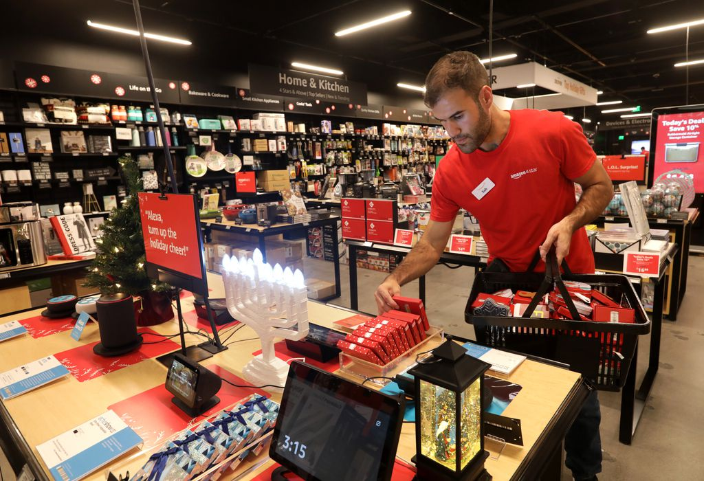 Sab Mirzaei stocked a seasonal items table Tuesday in the Amazon 4-Star store at Stonebriar Centre in Frisco.