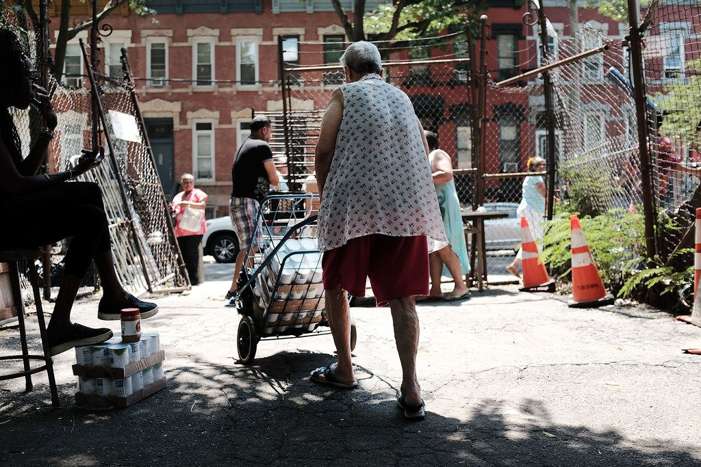 A woman walks away from a free food pantry in the Bronx, one of the poorest congressional districts in the nation, on July 11, 2018 in New York City. A recently published report by the United Nations claims that 40 million Americans live in poverty and 18.5 million Americans live in extreme poverty. The report, which has been disputed by the Trump administration, notes America also has one of the highest child poverty rates in the developed world, at 21 percent.