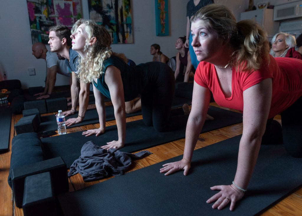 From left: Andrew Falcinelli, Alex Fox, Amanda Dunnavant and Ann Ryan participate in a stretching and meditation class at the Refuge Meditation in Dallas.