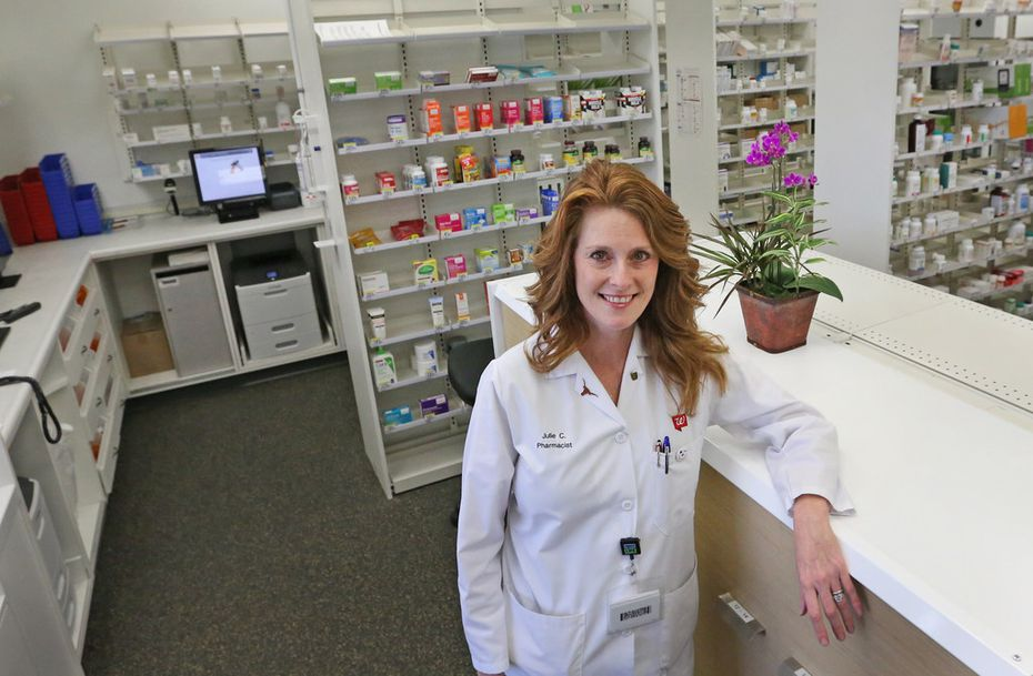 """Pharmacist Julie Caldwell said the Walgreens Community Pharmacy at 7859 Walnut Hill Lane in Dallas looks """"completely different"""" from other Walgreens."""