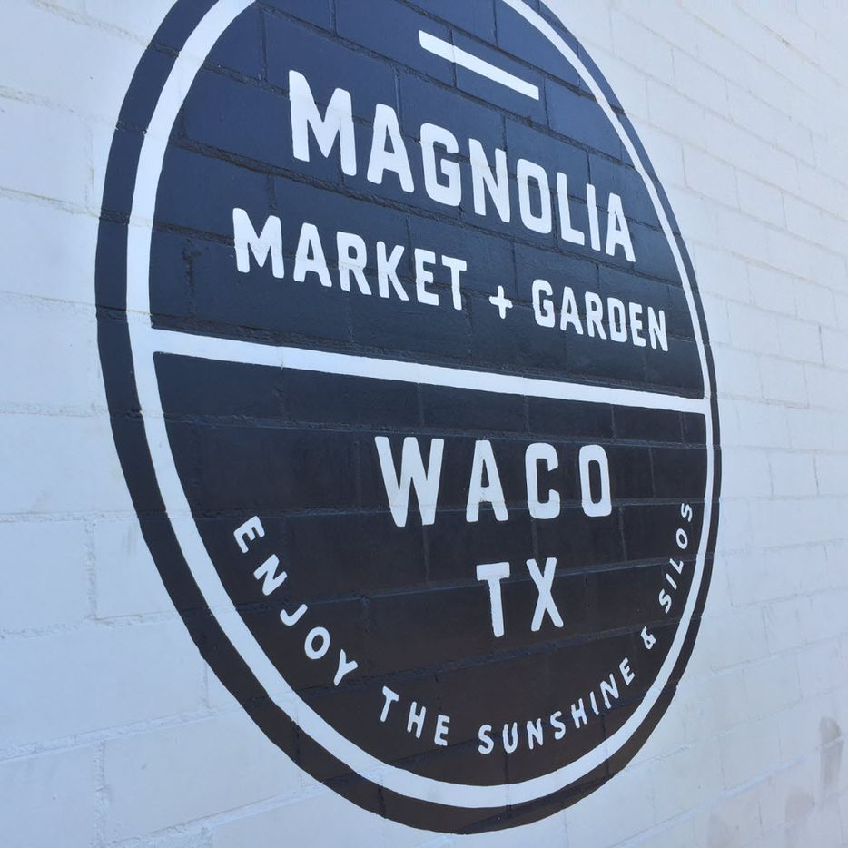 Logo painted on the side of a building at Magnolia Market at the Silos in downtown Waco.