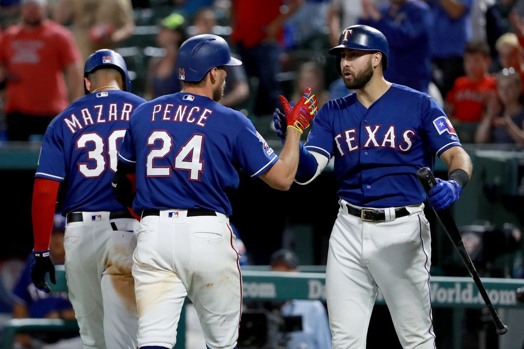 ARLINGTON, TEXAS - MAY 20: Hunter Pence #24 of the Texas Rangers celebrates with Joey Gallo #13 of the Texas Rangers and Nomar Mazara #30 of the Texas Rangers after hitting a two-run home run against the Seattle Mariners in the bottom of the seventh inning at Globe Life Park in Arlington on May 20, 2019 in Arlington, Texas. (Photo by Tom Pennington/Getty Images)