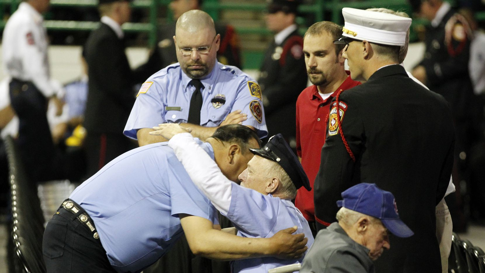West firefighters console each other before a memorial service for first responders who died battling the fertilizer plant fire in April 2013.