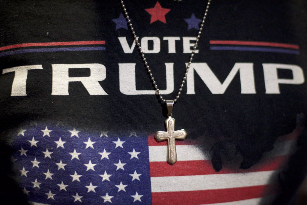 Minister E.J. Christian, 68, wears a Donald J. Trump themed shirt with a cross necklace before the Republican presidential nominee holds an event at the Eisenhower Hotel and Conference Center on Oct. 22, 2016, in Gettysburg, Pa.  Trump delivered a policy speech announcing his plans for his first 100 days in office.