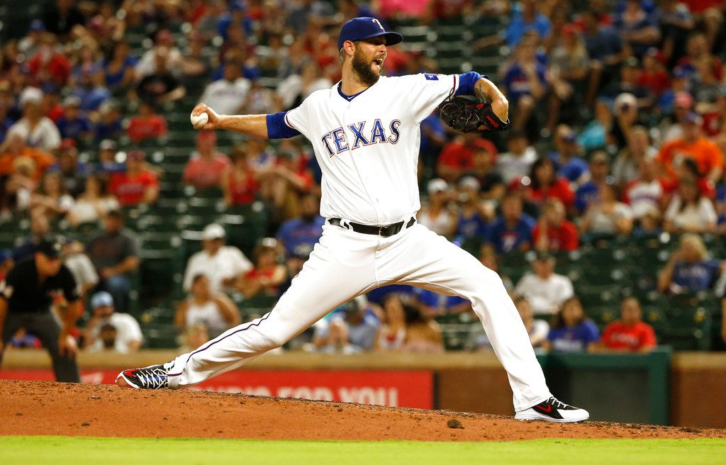 Texas Rangers relief pitcher Chris Martin (31) throws against the San Diego Padres of a baseball game Monday, June 25, 2018, in Arlington, Texas. The Rangers won 7-4. (AP Photo/Ron Jenkins)