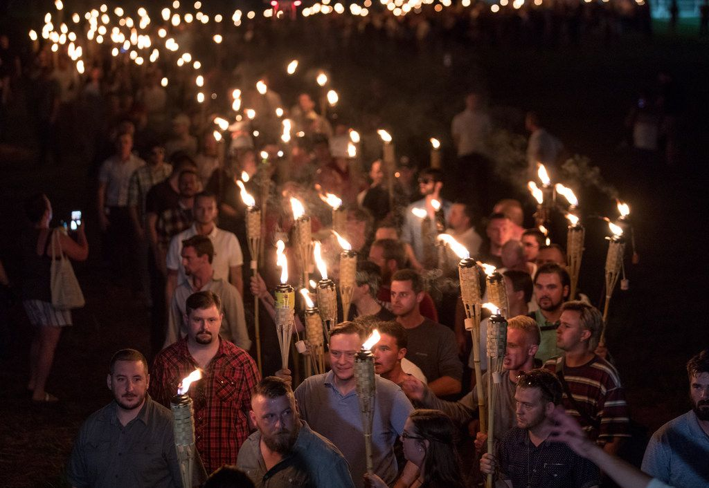 White nationalists and white supremacists carried torches at the 2017 Unite the Right rally in Charlottesville, Va., which turned violent and left one person dead. The American Identity Movement, known at the time as Identity Evropa, helped plan that rally.