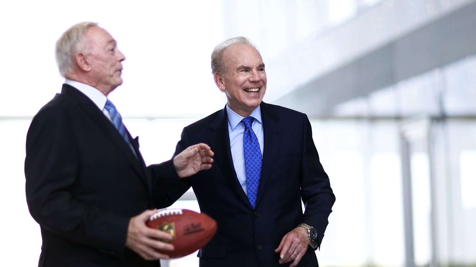 Former Dallas Cowboys quarterback Roger Staubach shares a laugh with Dallas Cowboys owner and general manager Jerry Jones at The Star in Frisco development.
