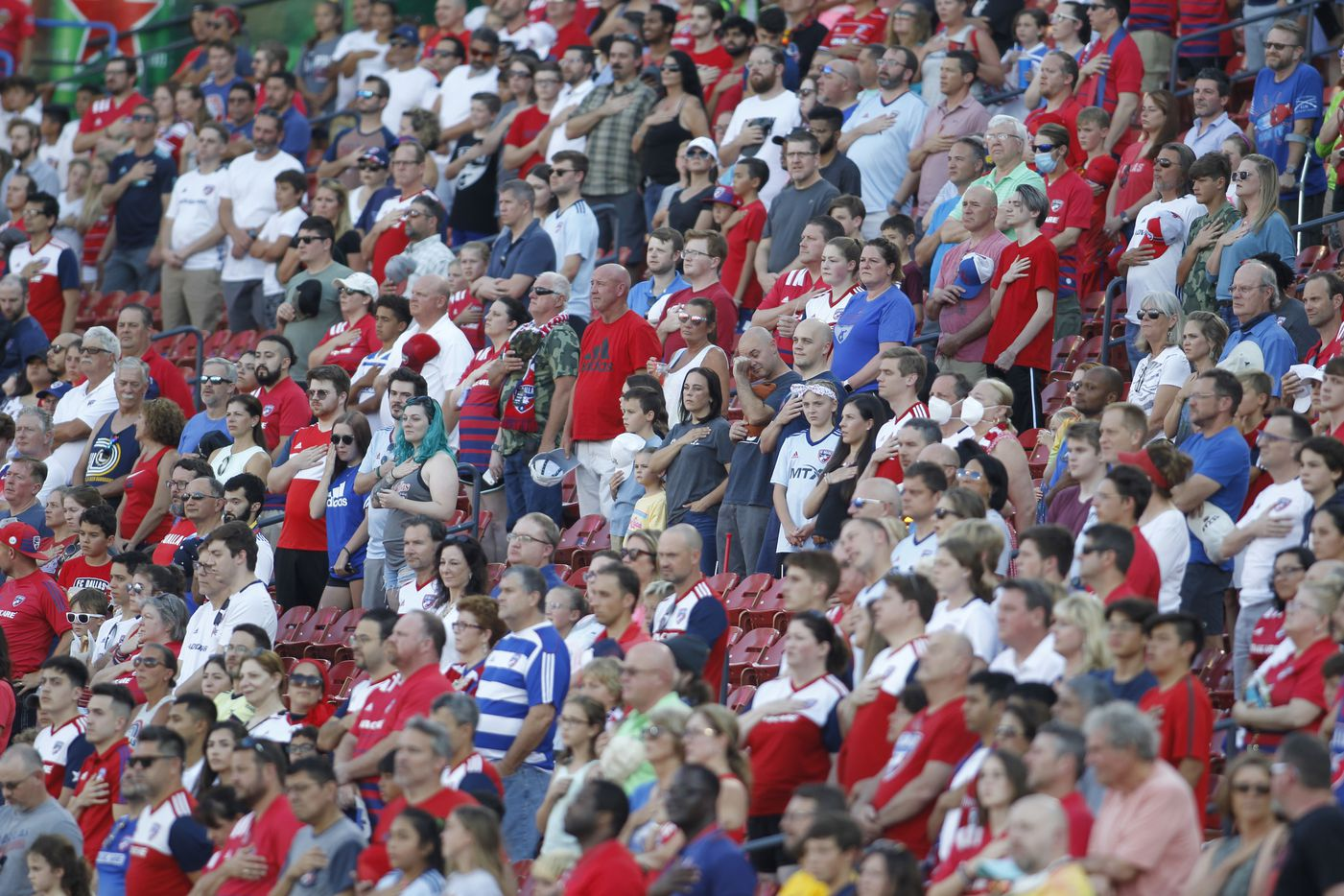 A large contingent of FC Dallas fans pause for the playing of the national anthem prior to the start of their match against Minnesota United. The two teams played their MLS match at Toyota Stadium in Frisco on June 19, 2021. (Steve Hamm/ Special Contributor)