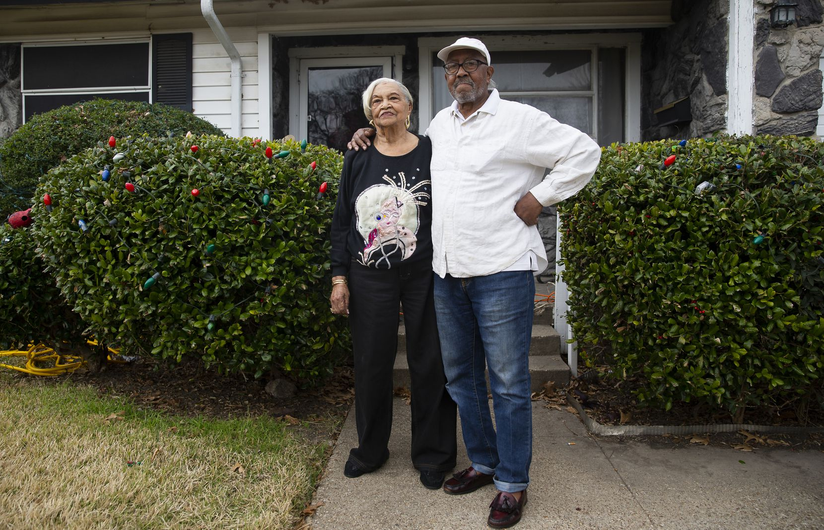 """Marion Washington and her son, Charles, in front of their home of more than 60 years.  """"This story is not just about us, it's about the Hamilton Park community,"""" Charles said."""